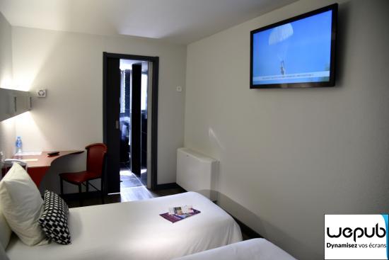 Chambre hôtel affichage dynamique